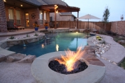 <h5>Outdoor Fireplace - Coppell</h5><p>Signature Pools & Spas - Custom Swimming Pools</p>