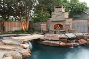 <h5>Outdoor Fireplace - McKinney</h5><p>Signature Pools & Spas - Custom Swimming Pools</p>