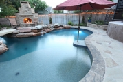 <h5>Outdoor Fireplace - Richardson</h5><p>Signature Pools & Spas - Custom Swimming Pools</p>