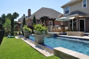 <h5>Outdoor Landscapes - Richardson</h5><p>Signature Pools & Spas - Custom Swimming Pools</p>