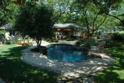 <h5>Landscape Design - Richardson</h5><p>Signature Pools & Spas - Custom Swimming Pools</p>